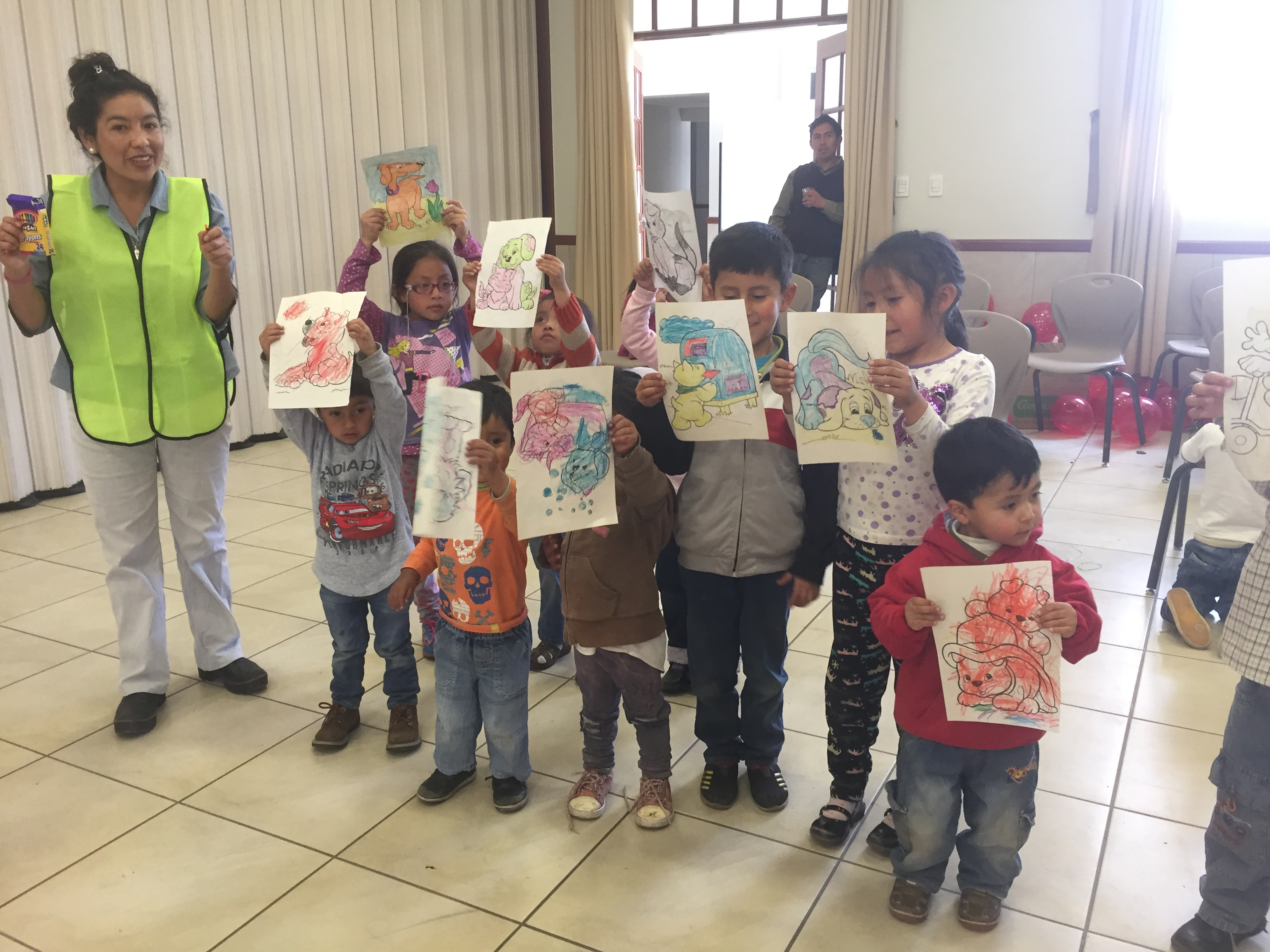Cusco-Christmas-party-children-show-their-artwork