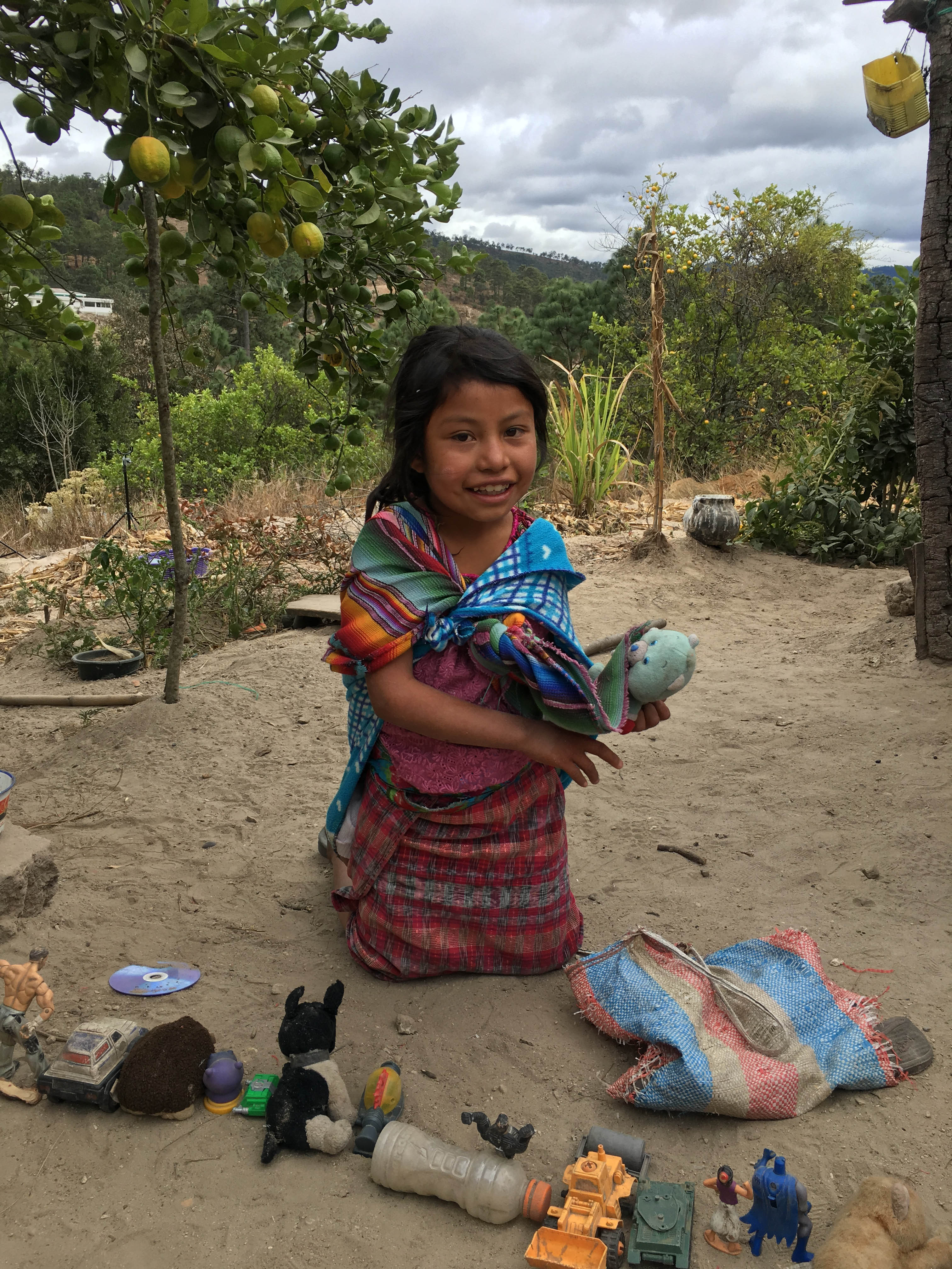 Gautemala-Mayan-girl-and-her-favorite-toys