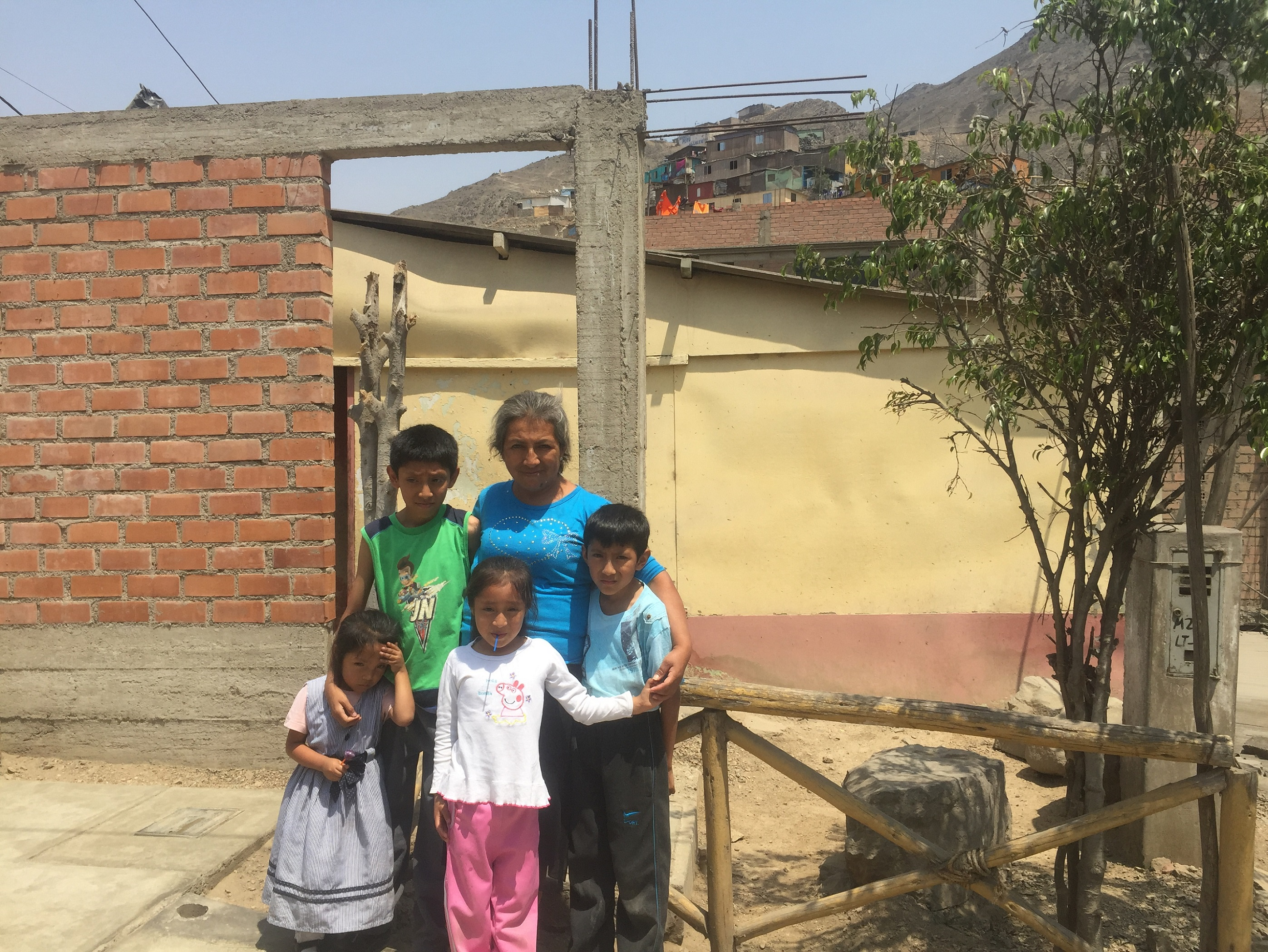 Lima-family-visit-home-on-side-of-the-mountain