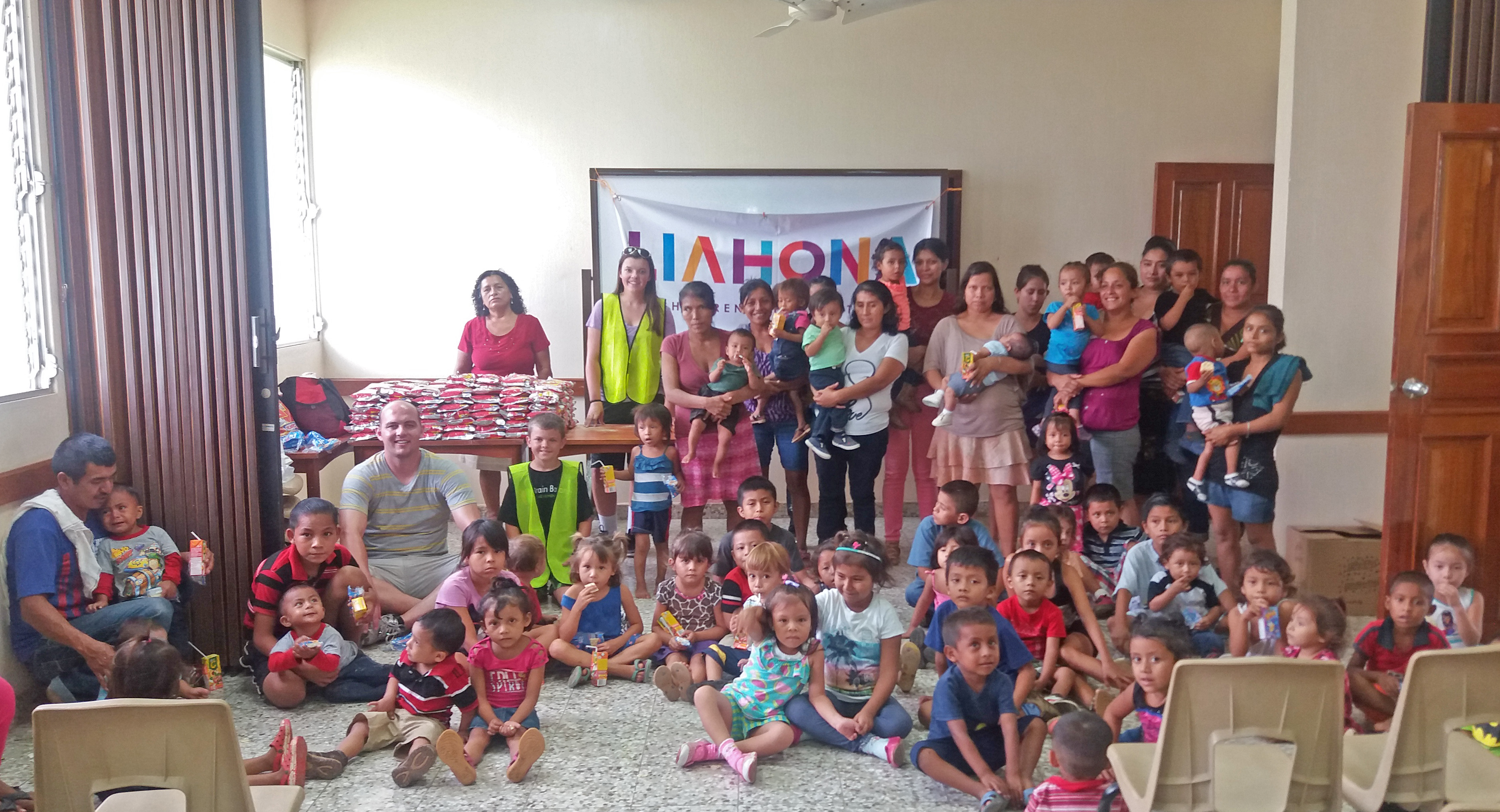 Nutritour-Guatemala-2016-3-with-children-and-families-in-chapel-cropped