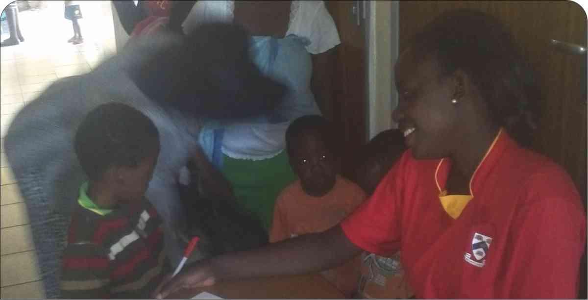Bulawayo 3 2016 4 Stake Coordinator Enrolling Children