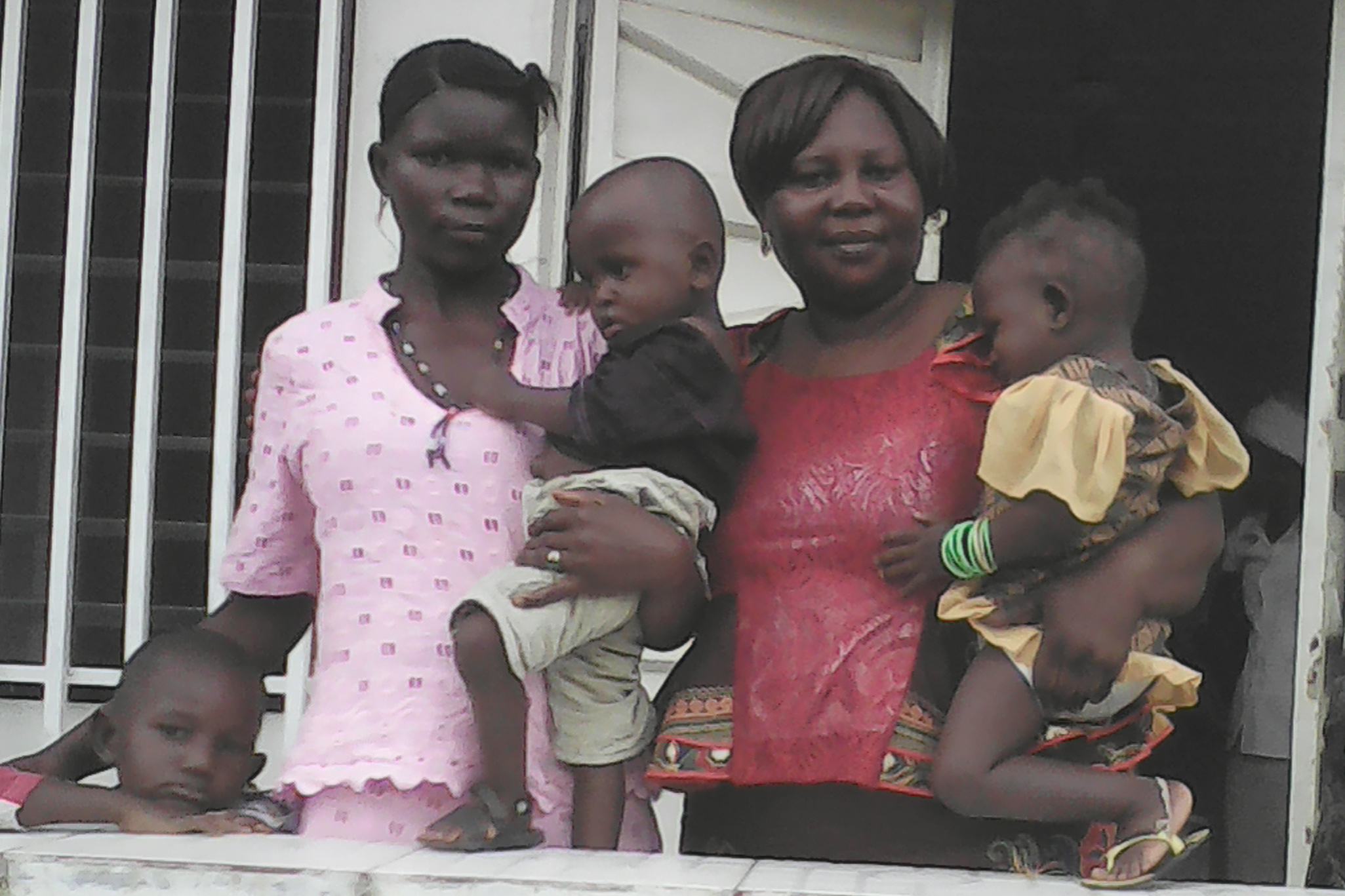 Sierra-Leone-9-25-2016-Agnes-with-twins-and-mother-at-church-investigating-and-soon-to-be-baptized-parents-Cropped